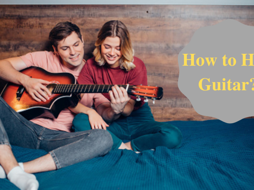 how to hold guitar